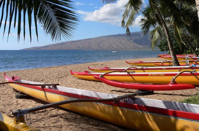 canoes on a beach in Maui